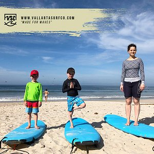 Little guys and mom ready to surf
