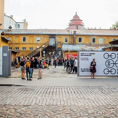 To most events currently the entrance is from A.Kalniņa street - please look for the big grey gate.