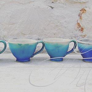 Turquoise stoneware tea cups.