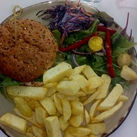 fabulous tender chicken burger with salad and home made chips.