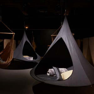Relax room with many type of hammocks, massage chairs and beds.