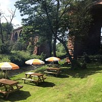 Enjoy a drink in our tranquil garden next to the River Sour
