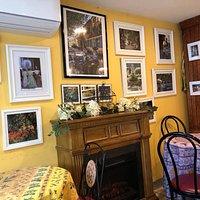 Far wall with art reflecting France which can be purchased.