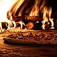 Traditional hand-crafted, wood-fire, Neopolitan style pizza.