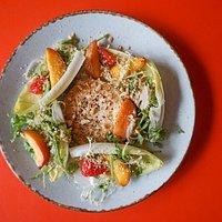Seasonal salad with Roast Peach, Goats Cheese, Balsamic Reduction, Strawberries, Almonds, Chicory & Rocket