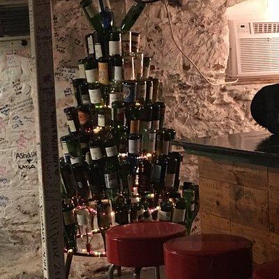 Wine bottle tree in the bar.