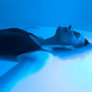 Woman in a floatation tank during a float session