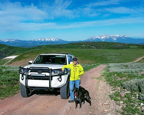 """David and his """"assistant"""" Moya along one of the backroads travelled during the photo tours held here in the Wasatch and Uinta mountains of Utah."""