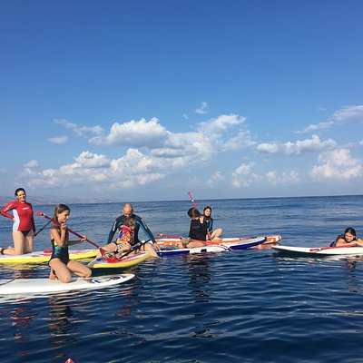 Paddle boarding lesson in front of Aphrodite Beachfront Village Gaziveren