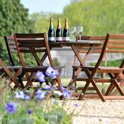 Outside seating - Wines are available to buy by the bottle or glass and enjoyed on our terrace or taken away with you