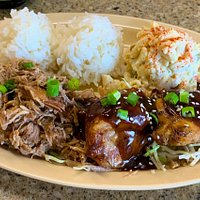 Combo plate with slow roasted $ pulled Kalua Pork and two thighs of Shoyu Chicken. Two scoops rice and one scoop of Mac salad