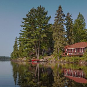 One of our cabins with its dedicated Killarney Lodge canoe on a sunny summer morning.