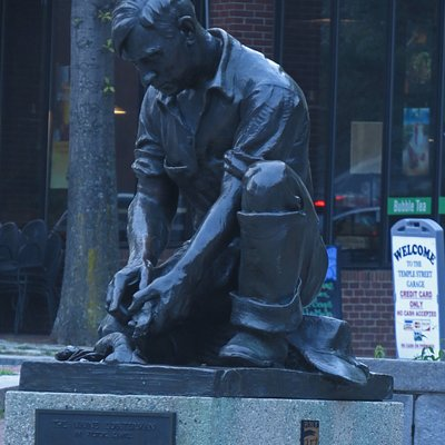A bronze statue is found in a city pocket park on Middle Street, just above Portland's Old Port district.