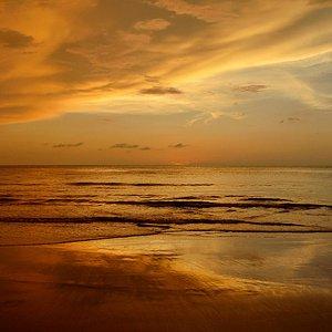 Beautiful afterglow and reflection of sunset at Sabandar Beach, Tuaran, Sabah, Malaysia.