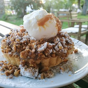 Apple Pie with Caramelised Almond Crumble and Vanilla Ice Cream with Caramel Sauce on Top