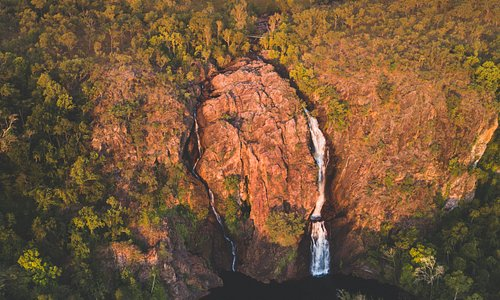 Situated in a monsoon forest with sweeping sandstone views, dive into the crystal-clear plunge pools of Florence Falls
