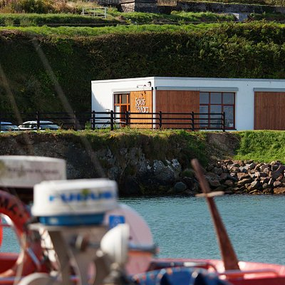 Our bathhouse is situated right on the working fishing pier at Helvick or Cé Heilbhic in the Gaeltacht area of An Rinn, just at the mouth of Dungarvan Bay.  the building itself was originally built for the fishmen to sell their catch once landed.