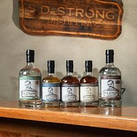 Our award-winning spirits include S.D. Strong Vodka, Pillar 136 Gin, Barrel-Rested Gin, Straight Rye Whiskey, and Big Boom Bourbon.