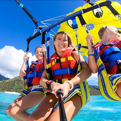young, wild an free above the lagoon of Moorea Moorea Parasailing like amazing