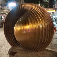 In the Queens Street Mall 'Gestation' sculpture by Baile Oakes. This was restored in 2018 for the 30th Anniversary of World Expo 88