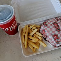 The standard burger, fries and soda combo.