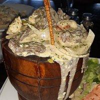 Mofongo with chicken and skirt steak, garlic sauce.