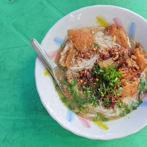 You have to try Mohinga! Myanmar's national dish of rise noodles covered in an aromatic fish soup, thinly sliced crunchy banana plant stem, tempurerd vegetables, chill and coriander is optional.