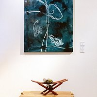 """Sarah Andersens Jagged wedged coffee table, Trevor Oliver-Kings wine rack and Carol Knights """"Simplest is the Hardest"""" art works in Tree-O gallery"""