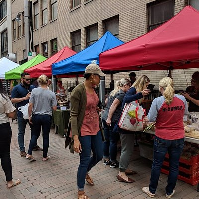 Shoppers visit merchants in Pearl Alley.