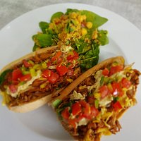 Jackfruit Carnitas with pico de gallo, grilled onions, guacamole, spinach and refried beans