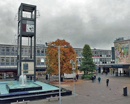 New Town Fountain & Clock Tower, with ugly concrete buildings in the background.