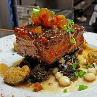 Mississippi BBQ glazed pork belly with southern greens, fried okra and a watermelon rind relish