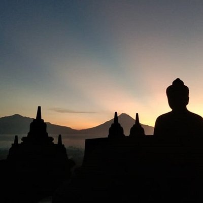 the great silhouette of Borobudur temple and volcanoes