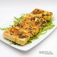 Tofu a la plancha en salsa de la casa.