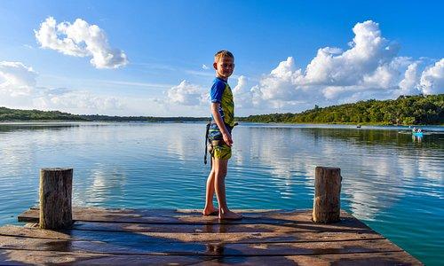 Jumping into Punta Laguna's lake.
