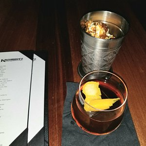 Vieux Carre cocktail with a bucket of Nitro Caramel Corn