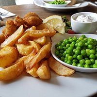Scampi, chips, peas and salad.