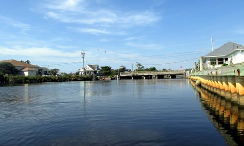 Eastward view of the Hwy 12 bridge, the take-out point for a kayak loop through the village.