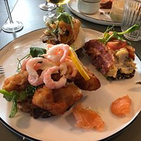 Fried Fish, Shrimps and smoked salmon. Beef Tenderloin with Fried Egg and Chicken Salat with Bacon