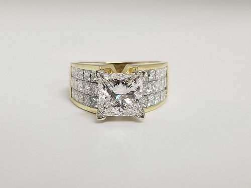 3.01ct H VS1 ( GIA certified) center diamond ring in 18kt yellow gold. 2.68ctw G/H color, VS1/VS2 clarity invisible set side diamonds 5.69ctw!