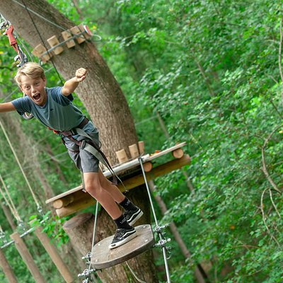 Our Four-Course Adult Adventure package for ages 10+ contains a mixture of obstacles ranging from Tarzan swings, ziplines, hanging nets, swinging surprises, wobbly bridges, and the grand finale: A 650 FOOT ZIPLINE!  The closest ziplines to Wilmington NC!