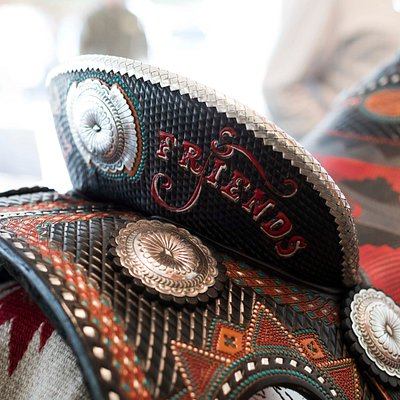 Buffalo Bill & Friends Saddle by Lisa and Loren Skyhorse Saddlery, By Western Hands' Legacy Artisans.