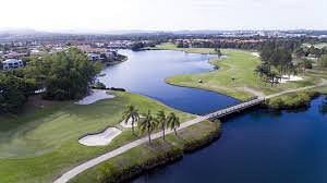 Aerial view of the 18th hole, par 5 at Palm Meadows Golf Course.  Double water carry to hit in two shots, if you're game!