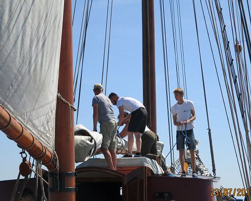 Folding the sail before entering the port
