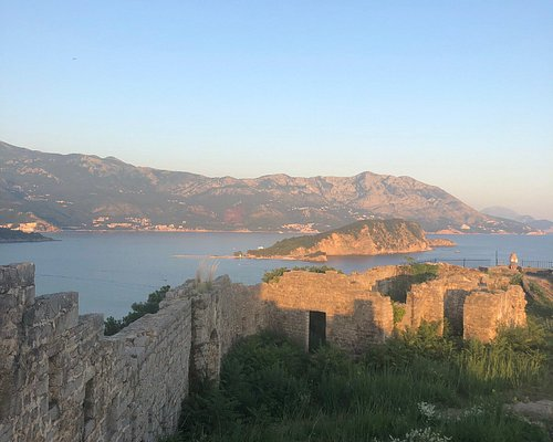 Mogren Fortress at sunset with a view of Old Town, Budva