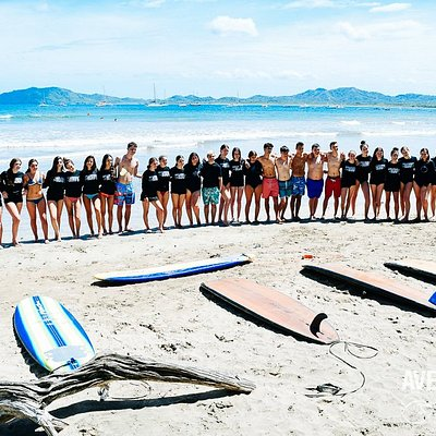 Friendship is built with good times and memories. Group of teens capturing a good one before their surfing lesson with Avellanas Surf School