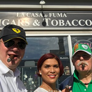 In front of Casa de Fuma Cigar Shop with the owner, Fawzi, in the green hat.