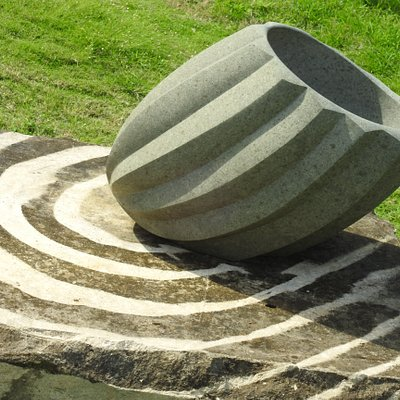 Hand carved andesite stone bowl located in the garden