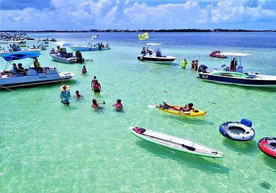 Meet new friends and the locals at the Islamorada Sandbar. Add paddleboards, kayaks, and snorkel to your All-Inclusive day... or BYOB (and everything else) on our bare-bones Simple Sandbar charter, when you are on a budget.