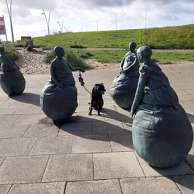 My dog with some of the sculptures.
